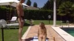 Sunbathing poolside bikini beauty