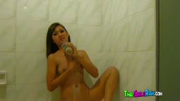 Thai chick gets slippery in shower