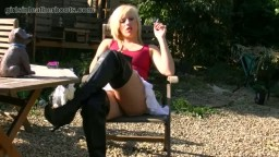 Kinky blonde smoking in leather boots and giving upskirt close ups of her sexy pussy